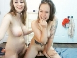 Two cam girls shows actions on Sybian toy