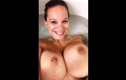 Girl plays in the bathroom with big toys
