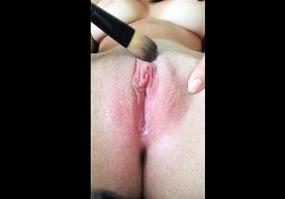 She teases her big clit with brushes <!-- width=