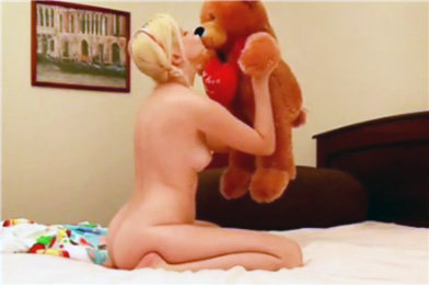 Sexy blonde teases with Teddy Bear and dildo