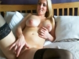 Blonde lady fingering her pussy