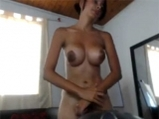 Young latina with big boobs masturbates on cam