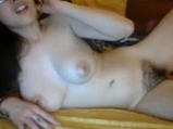 Asian girl with hairy pussy masturbates on webcam