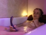 Blonde teen masturbates with toy in the bath