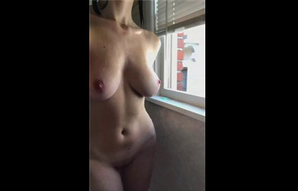Girl plays with big natural boobs