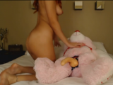 Redhead cam girl rides dildo on Teddy Bear <!-- width=
