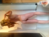 Amateur girl teases and masturbates with bottle shampoo