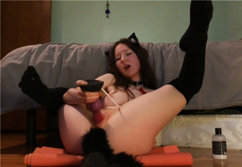 Cute young girl with anal pet tail plug