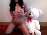 Sexy Asian girl udressing with Teddy Beer <!-- width=