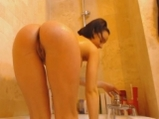 Hot brunette sexy washes in the shower