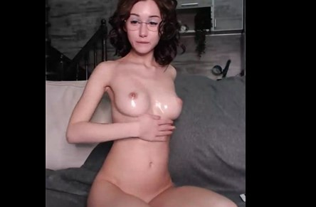Busty babe with oiled body fingering pussy