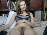 Girl shows us her tits as she fingers her hairy pussy
