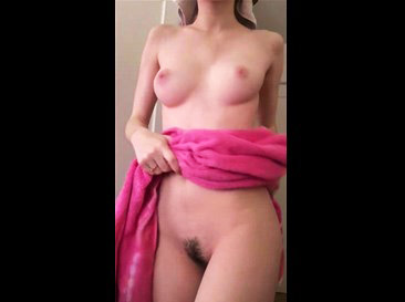 Young girl teases with towel <!-- width=