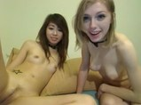 Two slender girls play together