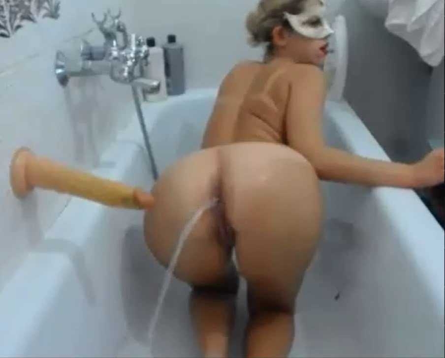 Blonde takes enema in the bath <!-- width=